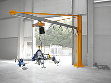 Crane and rail system with connected vacuum lifter
